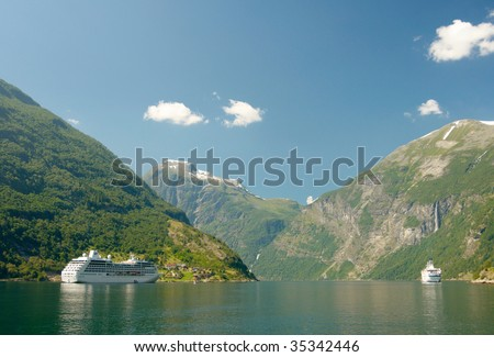 Two cruisers in Norwegian fjord - stock photo