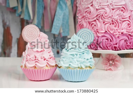 two cupcake in baby blue and baby pink for baby shower - stock photo