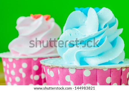 Two Cupcake on color background