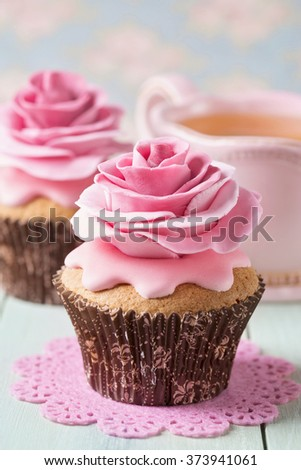 Two cupcakes with rose flowers