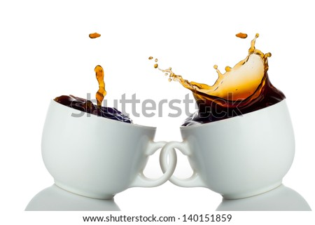 two cups of coffee creating splashes. Love symbol - stock photo