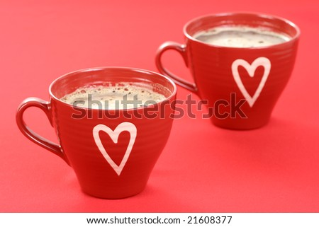 two cups of coffee on red background - food and drink