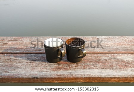 Two cups of coffee on wooden - stock photo