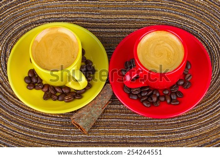 Two cups of coffee with coffee beans  - stock photo