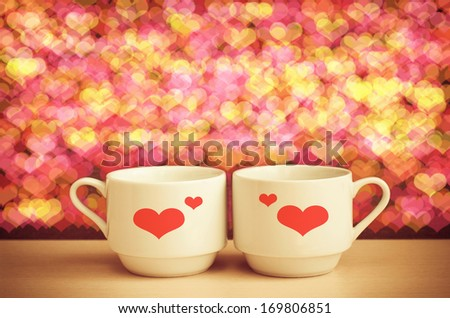 Two cups of coffee with heart prints. Romantic mood. St. Valentine's Day concept. - stock photo