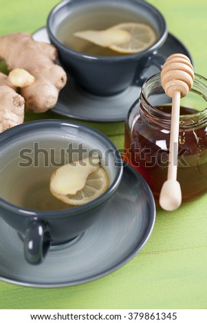Two cups of ginger tea with honey and lemon. Shallow dof - stock photo