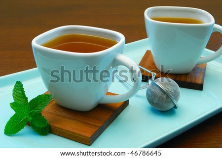 two cups of mint tea - stock photo