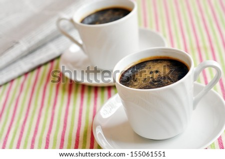 Two cups of morning coffee - stock photo