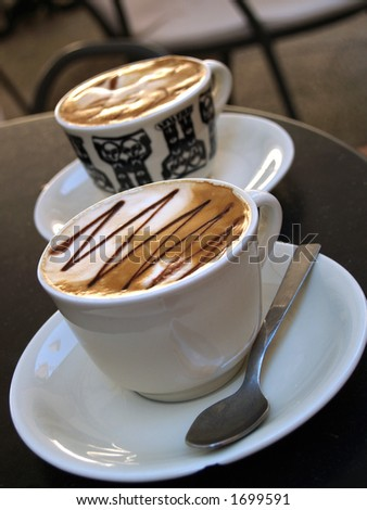 Two cups of serve coffee - stock photo
