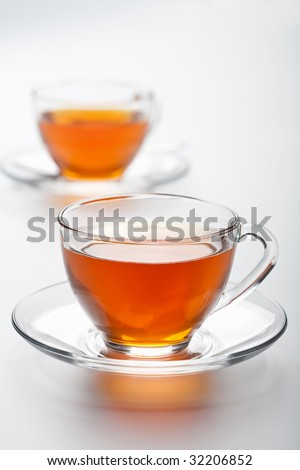 two cups of tea over white background - stock photo