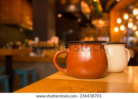 two cups standing on a table at the restaurant  - stock photo