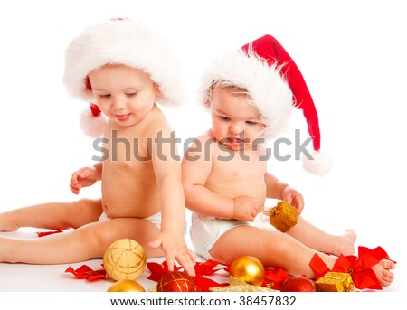 Two cute babies in xmas hats playing