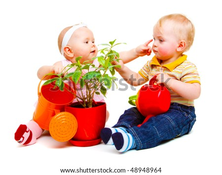 Two cute baby friends sit with watering pots