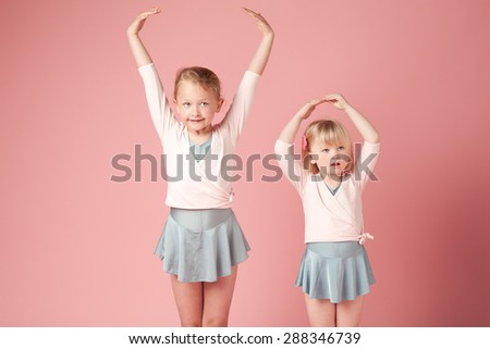 Two cute Ballerinas practicing their moves - stock photo