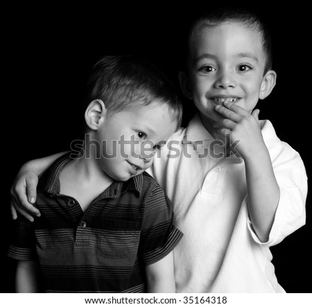 Two cute boys studio portrait - stock photo