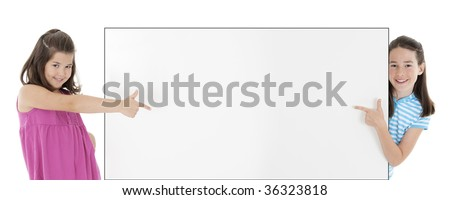 Two Cute Caucasian girls holding a blank sign - stock photo