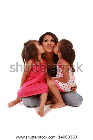 Two cute daughters kissing their mom on pure white background