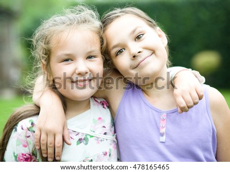 Two cute girls holding face in disbelief