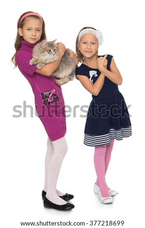 Two cute girls holding hands Big Siberian cat - Isolated on white background