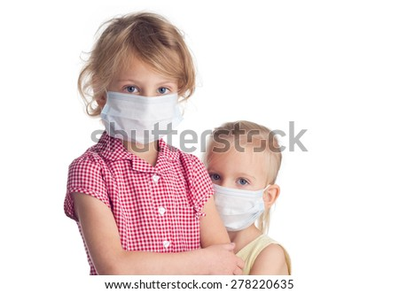 Two cute girls in medicine healthcare mask on white