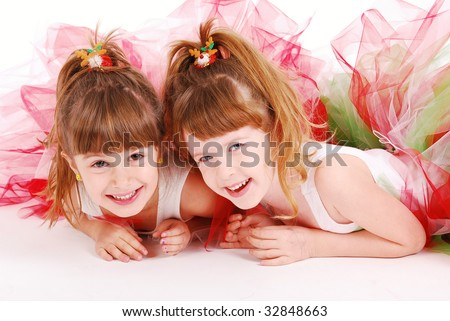 Two cute girls wearing tutu's - stock photo