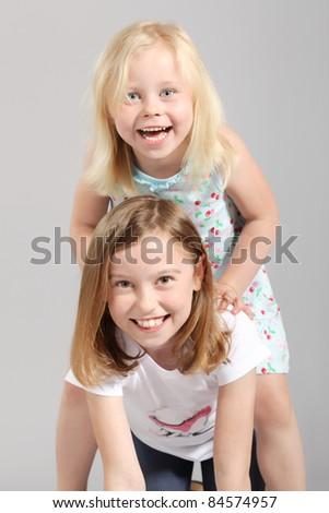 two cute little blond girls having fun - stock photo