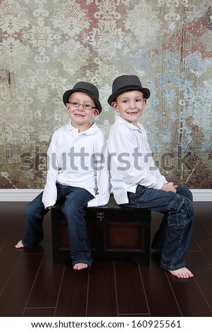 Two Cute little boys posing for camera