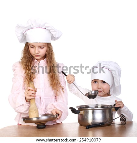 two cute little girls dressed as cooks