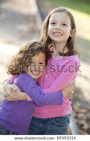 Two cute little girls hugging