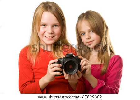 Two cute little girls with photo camera isolated on white - stock photo