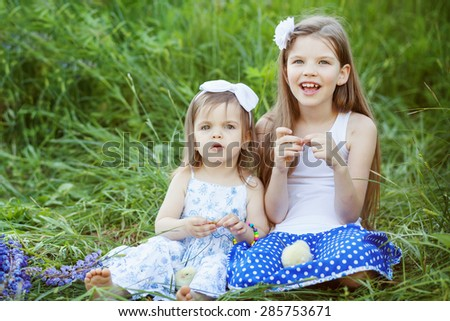 two cute  sisters outdoors - stock photo