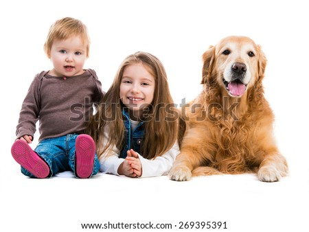 two cute sisters  with her dog golden retriever in the studio. Isolated on white background - stock photo