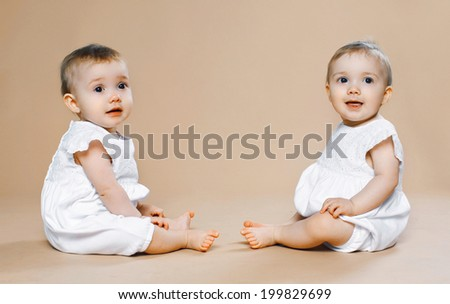 Two cute twins baby - stock photo