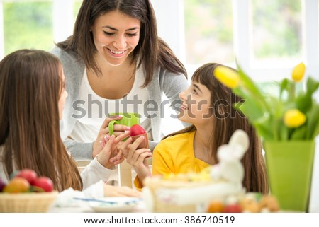 two cute with his mother preparing Easter eggs - stock photo
