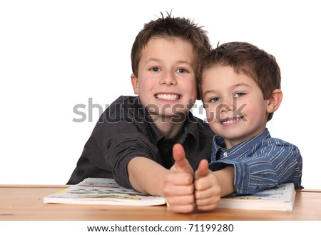 two cute young boys learning together - stock photo