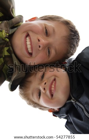 two cute young boys with a toothy smile - stock photo