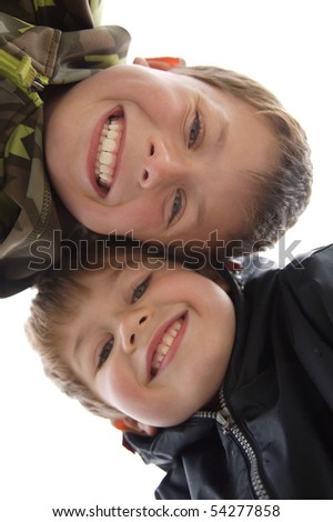 two cute young boys with a toothy smile