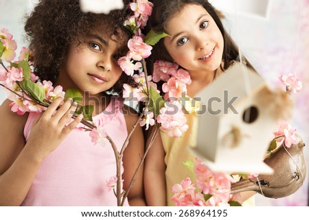 Two cute young girls - stock photo