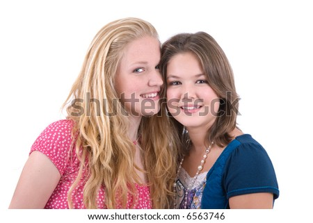 Two cute young teenagers with heads close together on white background