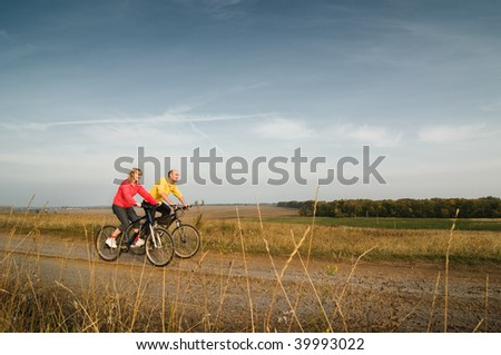 two cyclist relax biking at sunset - stock photo