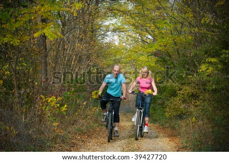 two cyclist relax biking outdoors - stock photo