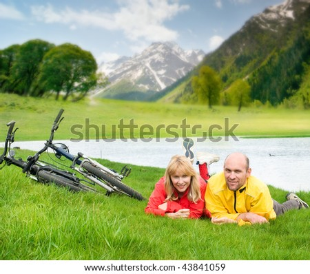 two cyclists in mountains - stock photo