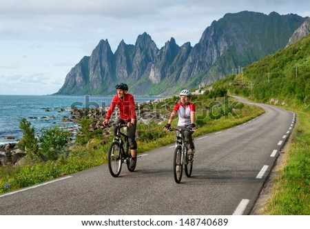 two cyclists relax biking in Norway - stock photo