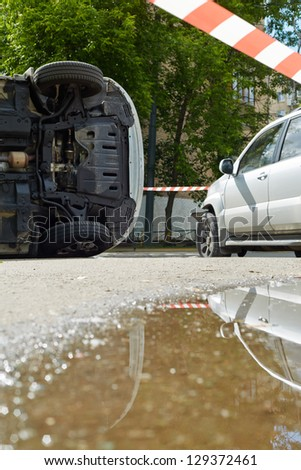 Two damaged cars at place of accident - stock photo