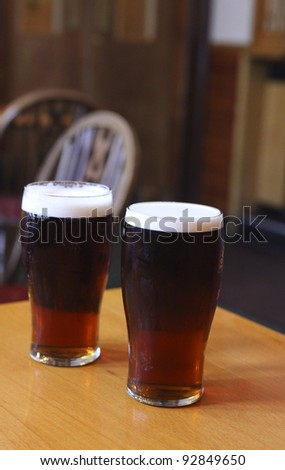 Two dark ales  on a pub table - stock photo