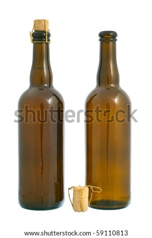 Two dark glass beer bottles and cork with golden wire. Isolated on white background - stock photo