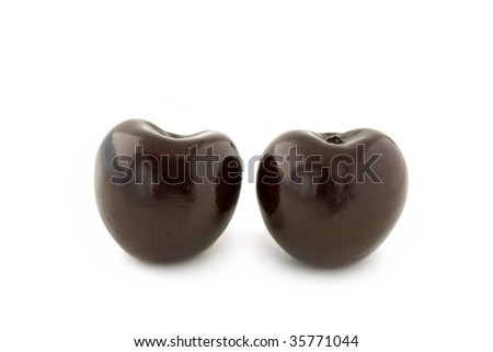 Two dark red cherries, without stalks. Isolated on white background, with shadow. - stock photo