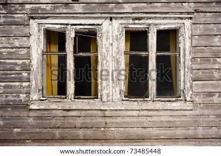 Two dark windows in old haunted house - stock photo