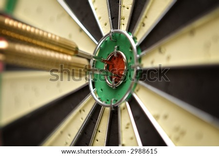 Two darts in the bull's eye. Shallow DoF. - stock photo
