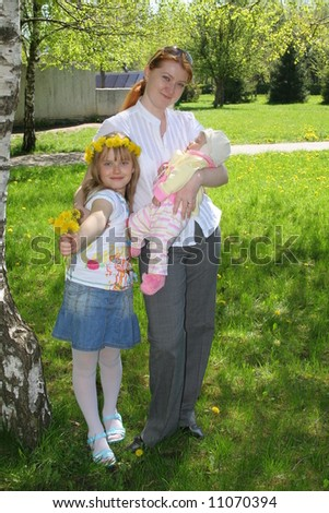 two daughters and mother in park